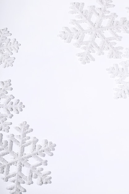 Snowflakes on white surface Free Photo