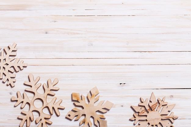 Snowflakes on wooden background Premium Photo