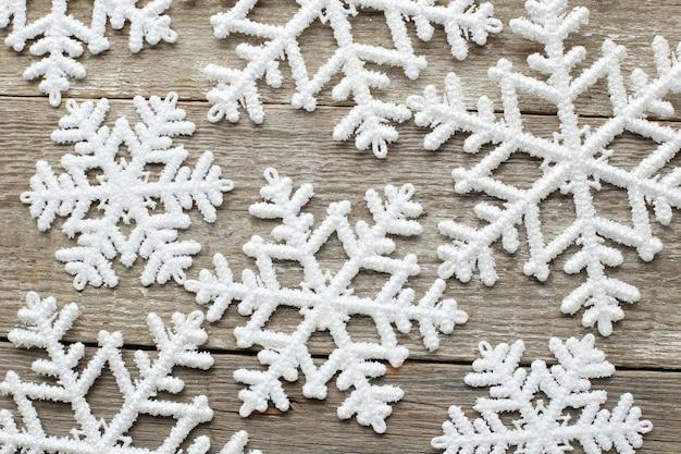 Snowflakes on wooden table Free Photo