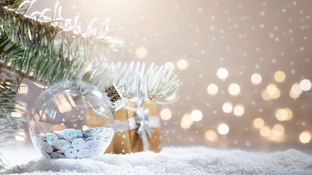 Snowy fir-tree branch with christmas lights bokeh Premium Photo