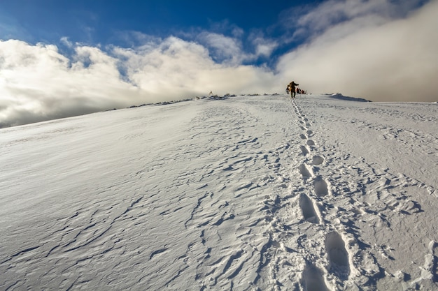 Snowy hill with footprints Premium Photo