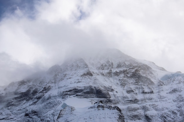 Snowy mountain on a cloudy day landscape Premium Photo