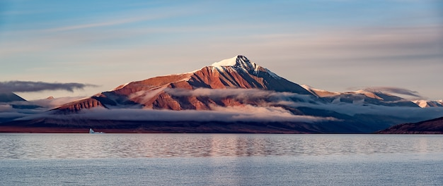 Snowy mountain over lake, beautiful landscape Free Photo