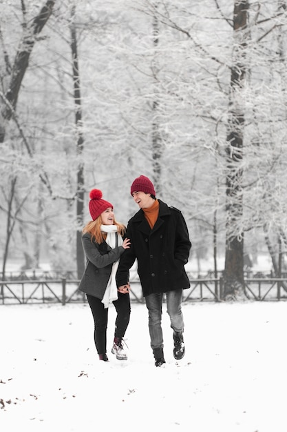 Snowy winter season with lovely couple Free Photo
