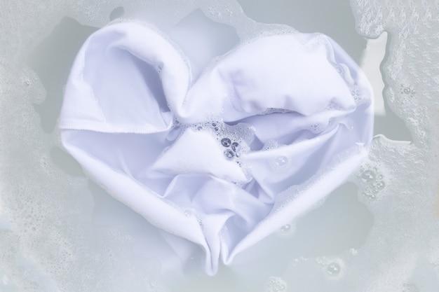 Soak a cloth before washing, white cloth Premium Photo