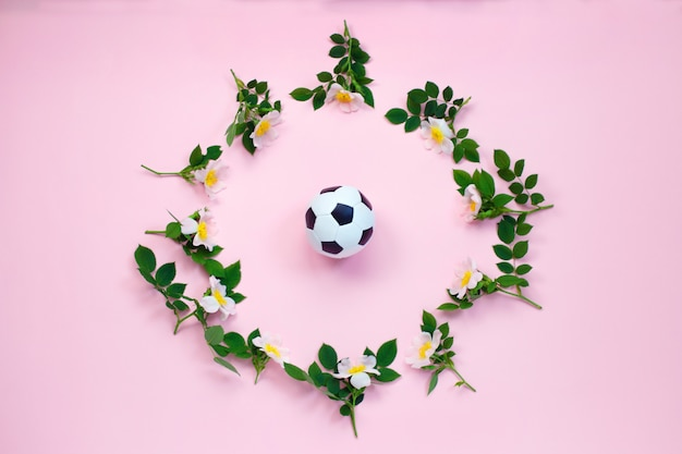Soccer ball and flowers Premium Photo