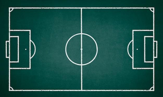 Campo di calcio disegnato su una lavagna verde Foto Gratuite