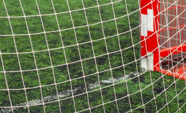 Soccer (football) field close up. sports net at the football goal. Premium Photo