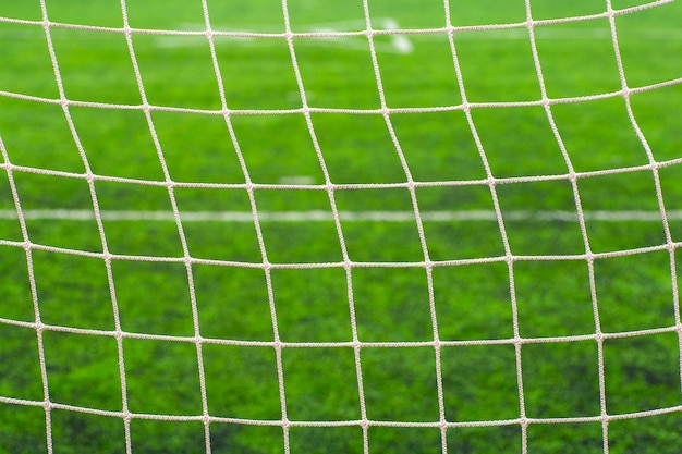 Soccer (football) field close up. sports net at the football goal. Premium Photo