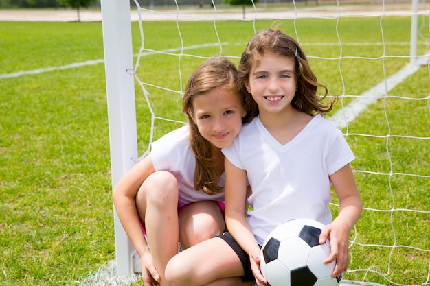 Soccer football kid girls playing on field Premium Photo