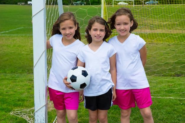Soccer football kid girls team at sports fileld Premium Photo