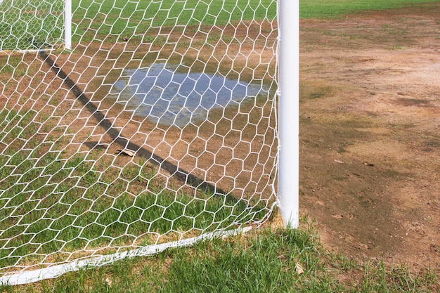 Soccer goal with grass field. Premium Photo