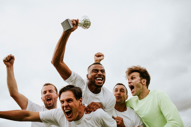 Soccer players team celebrating their victory Premium Photo