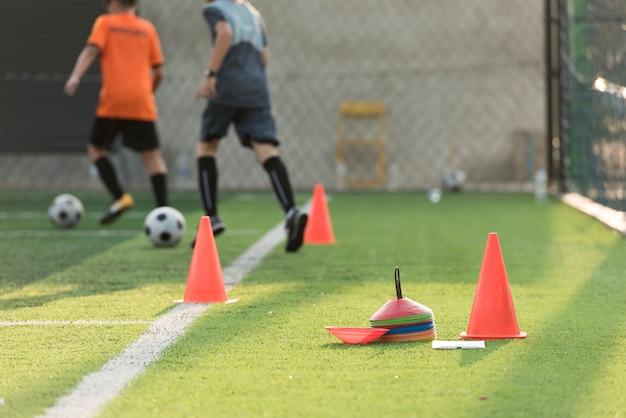 Soccer training equipments on field Premium Photo