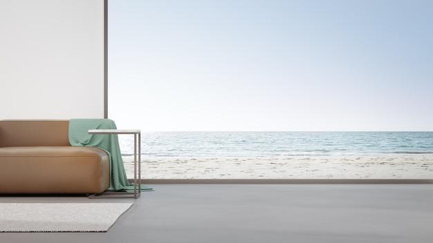 Диван на бетонном полу большой гостиной в современном доме или роскошной гостинице. Premium Фотографии