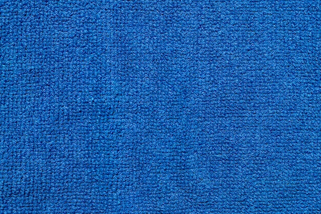 柔らかい青い繊維布生地のテクスチャ背景。 無料写真
