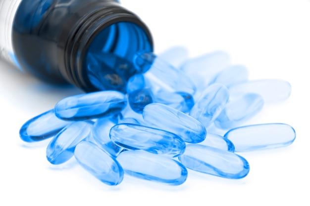 Soft gelatin capsule use in pharmaceutical manufacturing for contain oily drug. Premium Photo
