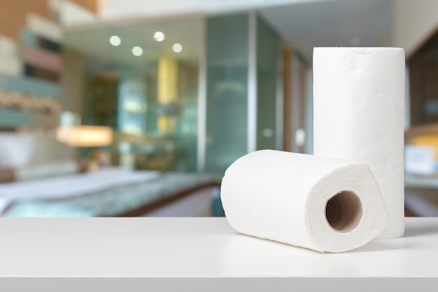 Soft paper towels on a white desk front view Premium Photo