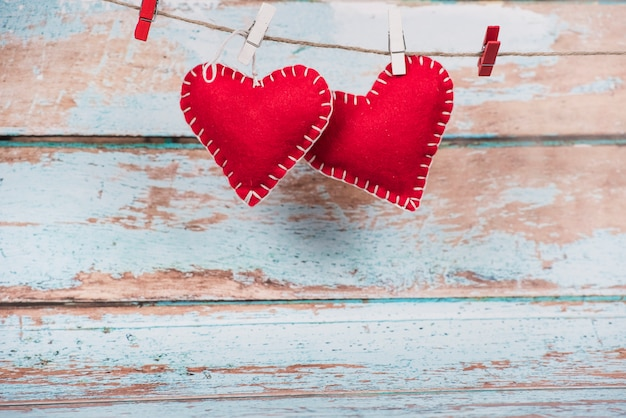 Soft small toy hearts pinned to rope Free Photo