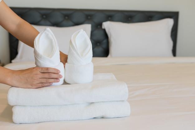Soft towels on bedroom. Premium Photo