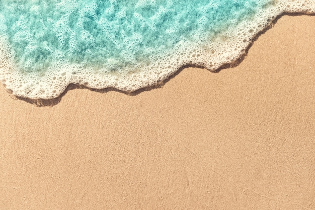 Soft wave lapped on empty sandy beach, summer background. copy space. Premium Photo
