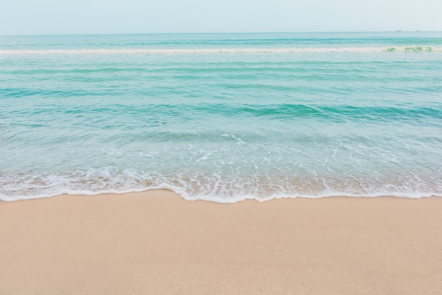 Soft wave of sea on empty sandy beach background with copy space Premium Photo
