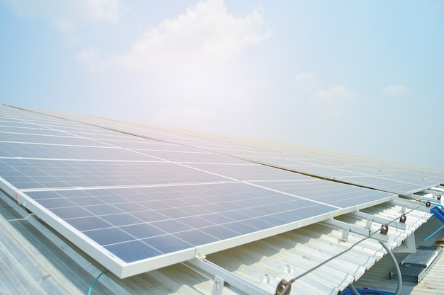 Solar cell in solar farm with green tree and sun lighting reflect Premium Photo
