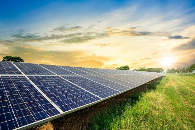 Solar panel cell on dramatic sunset sky, clean alternative power energy concept. Premium Photo