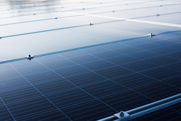 Solar panel install on roof-deck in big building for generation of electric power Premium Photo