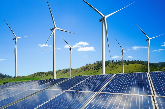 Solar panel and wind turbine farm clean energy. Premium Photo