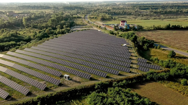 Solar panels in aerial view. posolar panels in aerial view. power farm producing clean energy Premium Photo