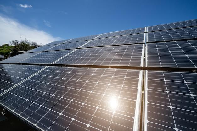 Solar panels against the blue sky with sunlight Premium Photo