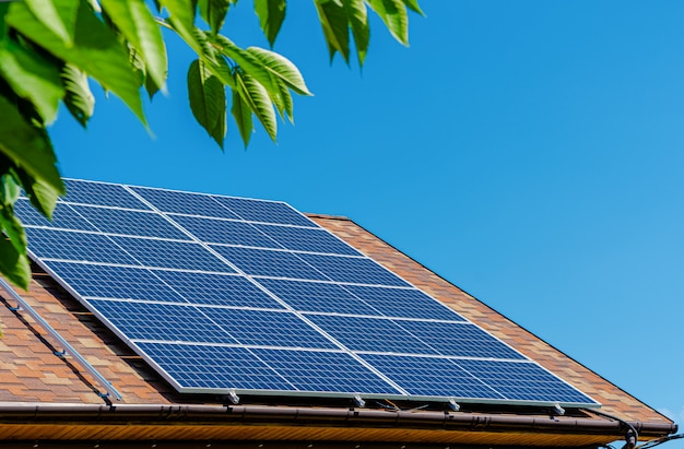 Solar panels on the roof. green energy and money savings concept. Premium Photo