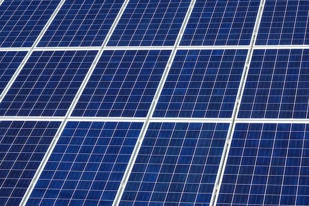 Solar panels under sunny blue sky Premium Photo