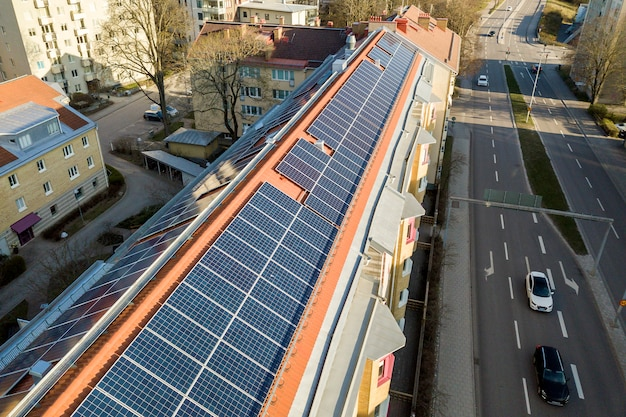 Solar panels system on high apartment building roof . Premium Photo