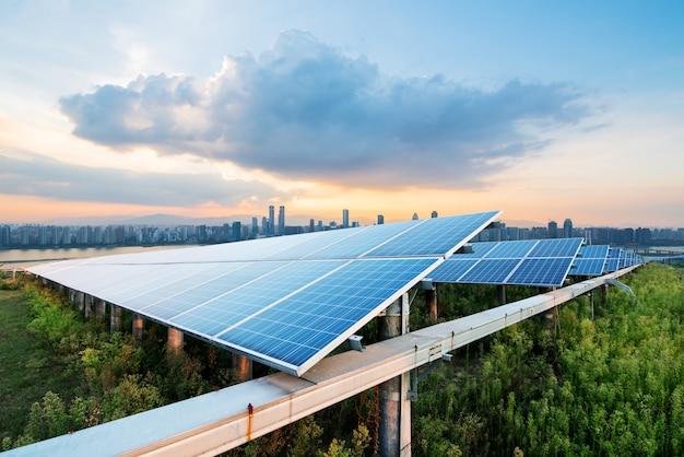 Solar panels with cityscape of singapore Premium Photo