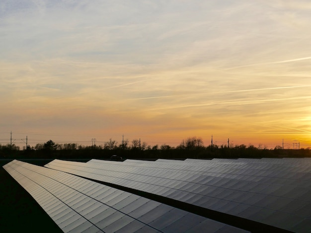 Solar power station surrounded by trees Free Photo
