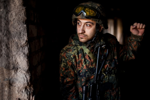 Soldier in the war with arms Premium Photo