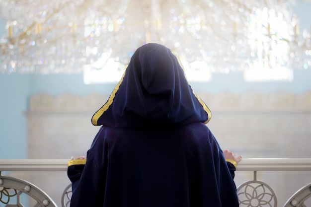 The solitude of a muslim woman in a mosque. | Premium Photo