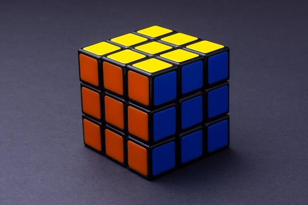Solved rubik's cube on black Premium Photo