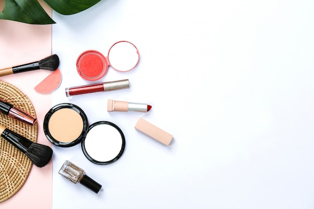 Some cosmetic products with sweet pink and white color paper background Premium Photo