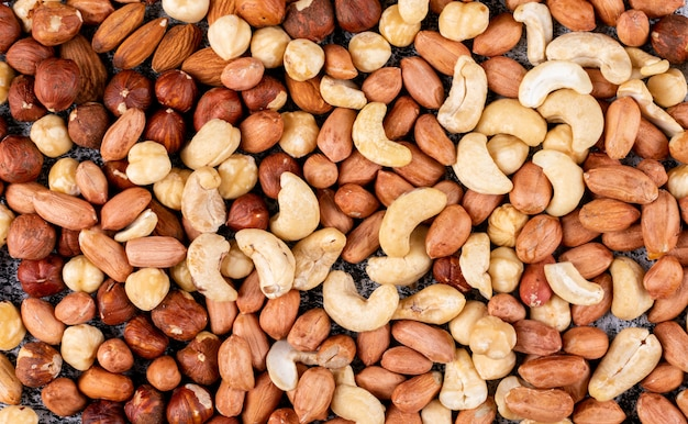 Some of different nuts with pecan, pistachios, almond, peanut, cashew, pine nuts close-up. Free Photo