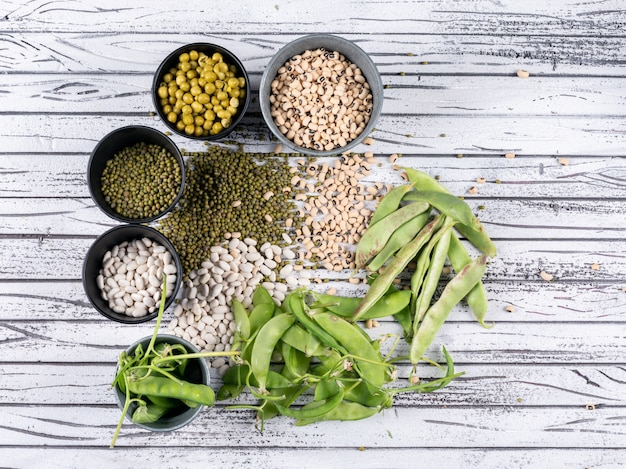 Some Different Types Of Peas And Beans In Buckets And Aside Free