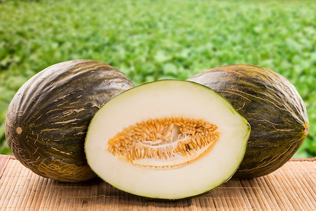 Some melons over a wooden surface. fresh fruits. Premium Photo