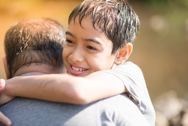 Son hug father with love Premium Photo