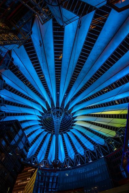 Sony center at potsdamer platz illuminated at night in berlin, germany. Premium Photo