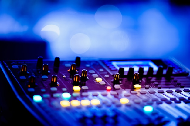 Sound check for concert, mixer control, music engineer, backstage Premium Photo