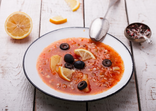 Soup solyanka,russian kitchen. Premium Photo