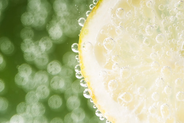 Sour lemon slice with defocused background Free Photo