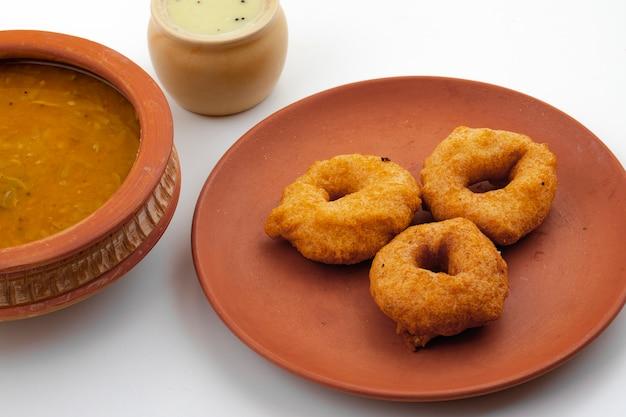 South indian popular breakfast vada, sambar or chutney Premium Photo